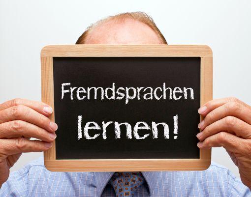 Tafel mit der Aufschrift Fremdsprachen lernen