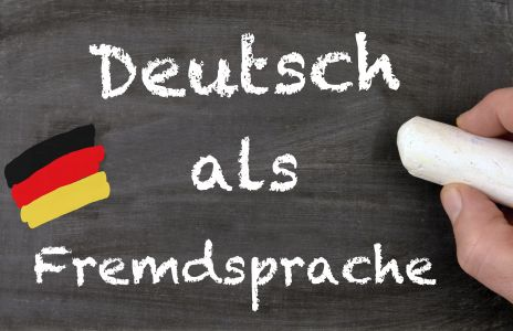 Deutsch als Fremdsprache auf eine Tafel geschrieben